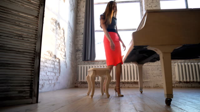 Beautiful girl playing on the grand piano. video
