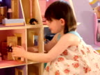 Beautiful girl plays doll's housewith video