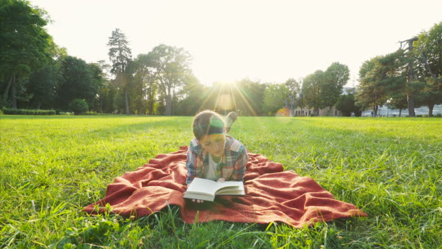 Beautiful girl reading a book. video