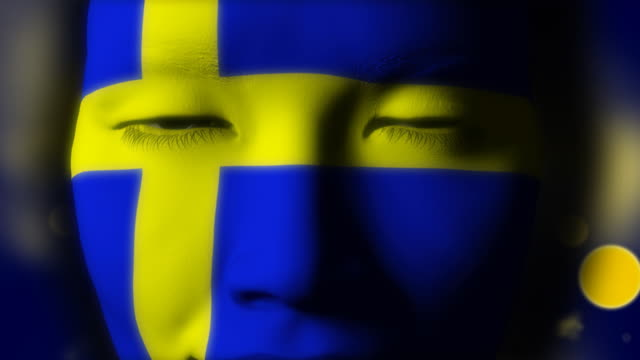 Beautiful girl Sweden flag face painted video