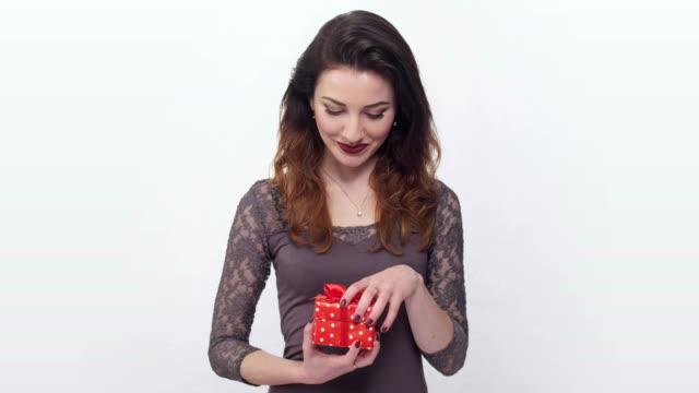 beautiful girl taken by surprise opening gift box video