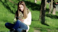 Beautiful Girl Using Tablet in the park video