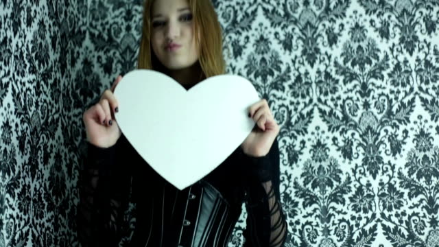 beautiful girl with a paper heart in hands video