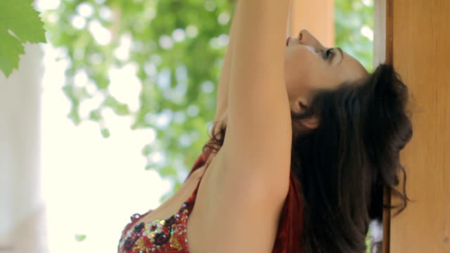 Beautiful girl with mehendi and dressed in clothes for east dance video