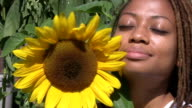 Beautiful girl with sunflower. video