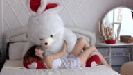 beautiful girl with toy on bed video