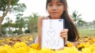 Beautiful girl write text 'I Love you' video