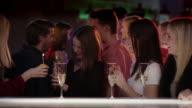 Beautiful girls celebrating birthday in club video