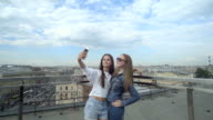 Beautiful Girls Taking A Selfie On The Roof video