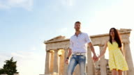 Beautiful Greek Couple walking and observing historical Greek architecture. video