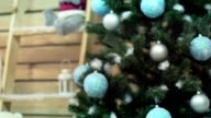 Beautiful holdiay decorated room with Christmas tree with presents under it video