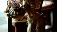 Beautiful indian statuette with girl in restaurant video