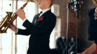 Beautiful jazz vocalist perform on stage with saxophonist. Duet. Click fingers video