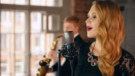 Beautiful jazz vocalist perform on stage with saxophonist. Duet. Live concert video