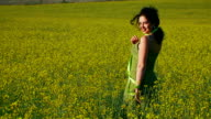 Beautiful lady in green dress is posing for camera video