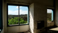 Beautiful landscape out of wide window of an abandoned hotel video