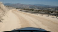 Beautiful landscape with long road and mountains from the riding car video