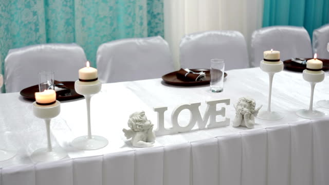 Beautiful lighted candles on table video