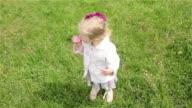 Beautiful little girl eats ice-cream video