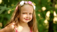 Beautiful little girl with floral headband video