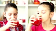 Beautiful Little Girls Drinking A Strawberry Smoothie video