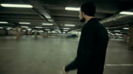 Beautiful man goes somewhere in the Parking lot video