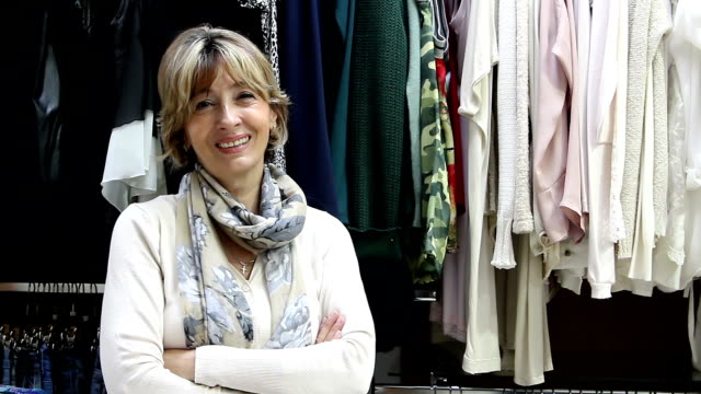 Beautiful mature clothing Store owner video