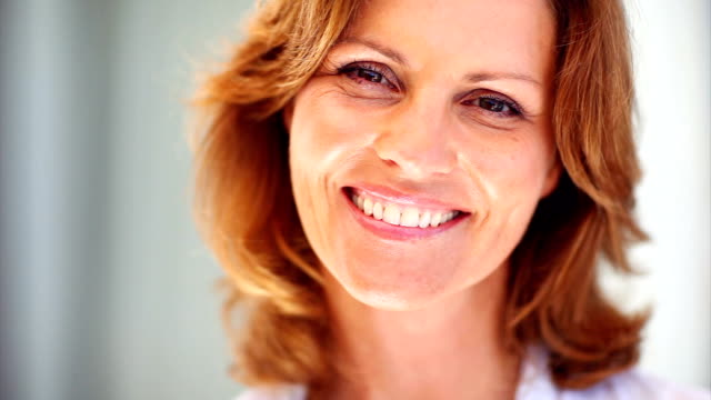Beautiful mature female smiling video