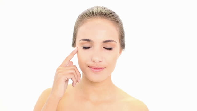 Beautiful model putting face cream on video