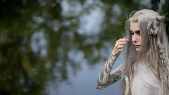 Beautiful model takes part in photo session on lake shore video