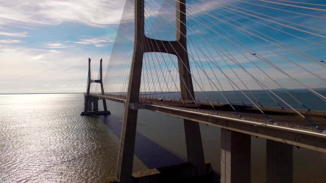 Beautiful modern bridge over the river aerial view video