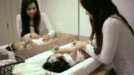 Beautiful mother changing her babies diaper video