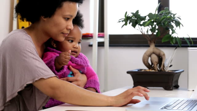 Beautiful Mother with her Baby in Home Office video