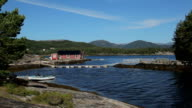 Beautiful Nroway, boathouse and boats on the fjord video
