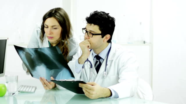 Beautiful Nurse and Doctor Looking at X ray video