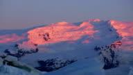 Beautiful Pan of Pink Sunrise Light on Snowy Mountain Peaks. video