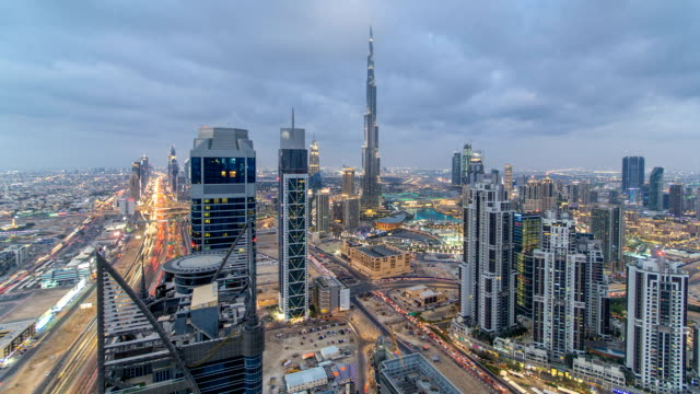 Beautiful panoramic skyline of Dubai day to night timelapse, United Arab Emirates. View of world famous skyscrapers video