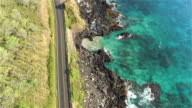 AERIAL: Beautiful picturesque countryside road above the rocky ocean cliffs video