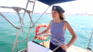 beautiful pirate at the helm of a yacht video