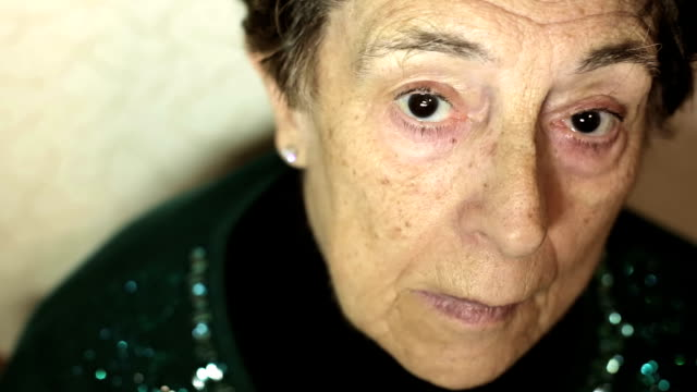 beautiful portrait of alone ederly  woman looking at the camera - old age video