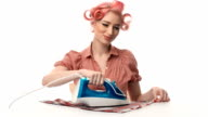 beautiful portrait of pin-up girls housewife with iron video