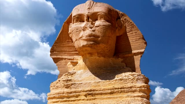 Beautiful profile of the Great Sphinx, blue sky day in Giza, Cairo, Egypt video