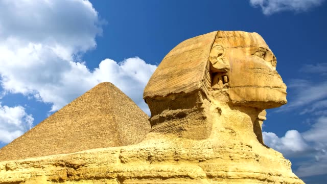 Beautiful profile of the Great Sphinx including pyramid, blue sky day in Giza, Cairo, Egypt video