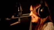 Beautiful Radio DJ in studio talking with audience video