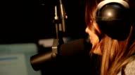 Beautiful Radio DJ in studio video