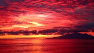 Beautiful red sunrise on Amed coastal beach in Bali video
