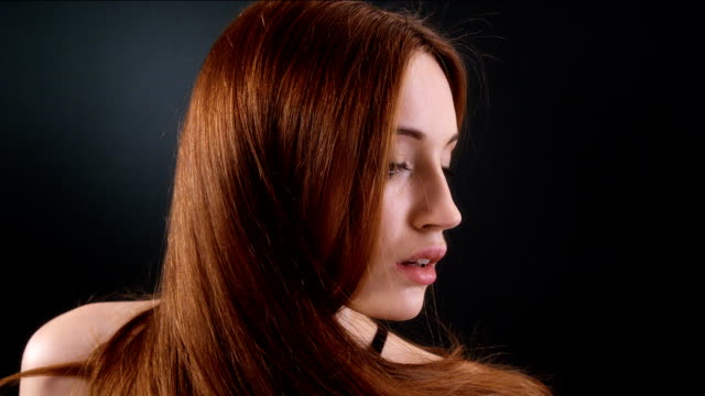 Beautiful redhead girl flipping her long hair video