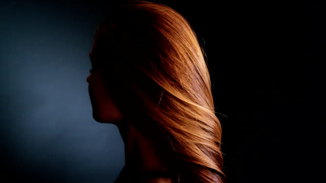 Beautiful redhead girl tossing her long hair video