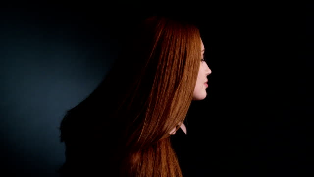 Beautiful redhead girl tossing her long hair video