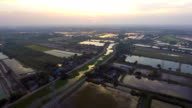 Beautiful Rice Farm and Irrigation Canals with Sunlight Reflection video